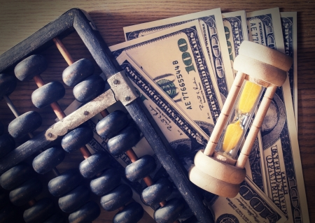 Vintage hourglass with abacus and money  Stock Photo