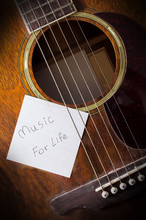 Music for life,guitar and message paper  photo