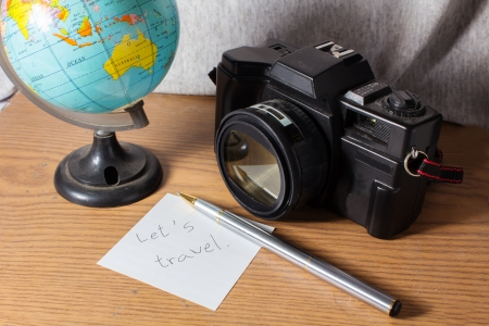 let s: Let s travel word,Old camera with globe and stationary
