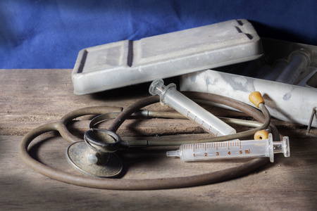 Old medical tools,syringe with stethoscope  photo