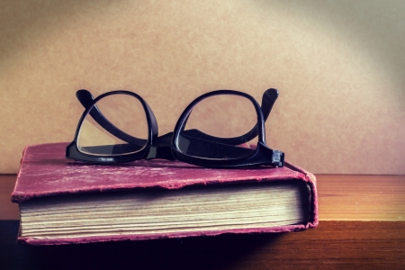 Vintage eyeglasses on book