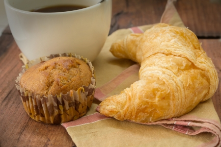 Black coffee with croissant and banana cake  photo