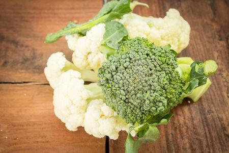 Broccoli with cauliflower on wood table  photo