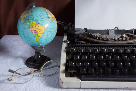 Old typewriter with globe and eyeglasses,still life  photo