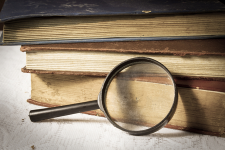 Magnifier with books,education background  photo