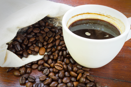 Coffee cup with beans,drinks background  photo