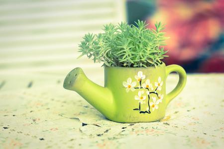 Green ceramic vase with green plant leaves,vintage