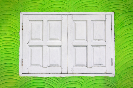 White window on green wall  photo