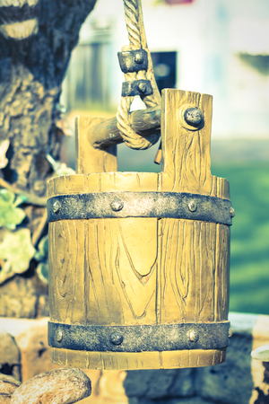 Wooden bucket, vintage style color  photo