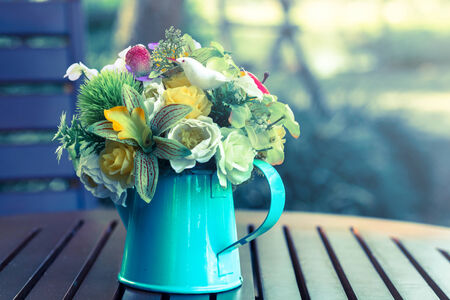 Flowers in metal vase,vintage color style  photo
