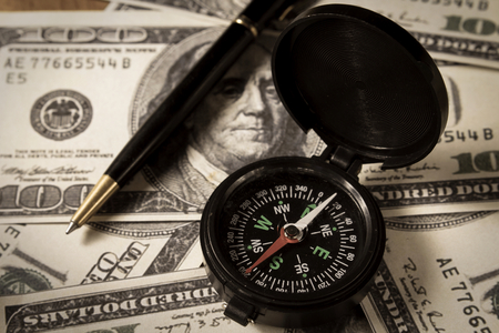 Compass with money and pen,business concept  Stock Photo