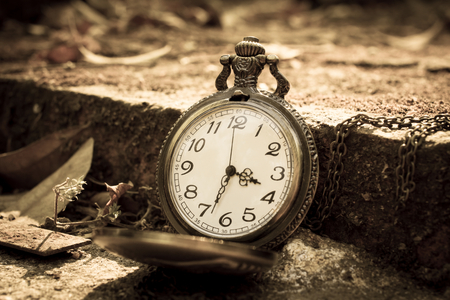 Clock on ancient brick,time concept