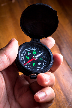 Compass in hand,vintage style color. photo