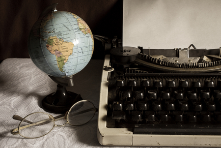 Still life globe and eyeglasses with typewriter,vintage color. photo