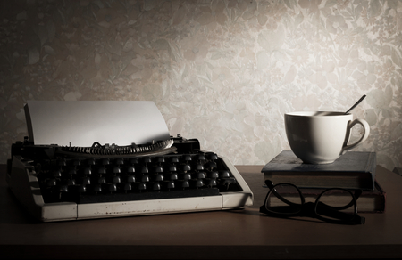 Still life typewriter with coffee cup,book and eyeglasses  photo