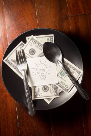 Idea and money on dish,business concept. photo
