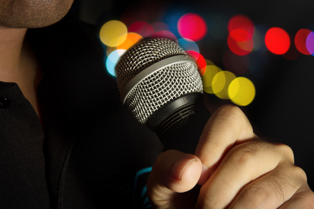 pop singer: Microphone in human hand,music concept.