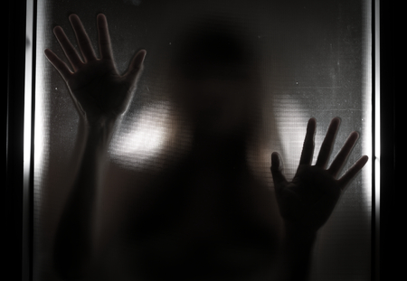 Woman shadow behind translucent glass. photo