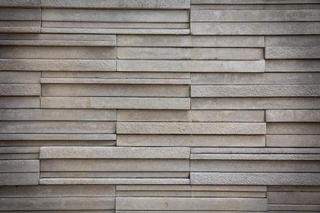 overbuilding: Grigio muro di mattoni di colore di pietra, di sfondo.