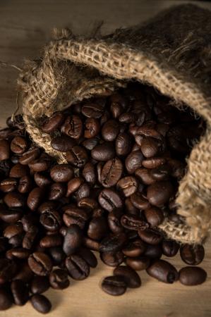 gunny: Coffee beans in gunny sack,still life. Stock Photo
