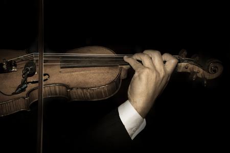 Vintage filtered color of violinist playing.