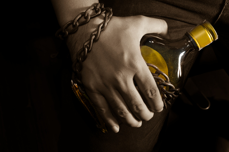Sepia tone filtered slave to alcohol ,addiction concept. Stock Photo