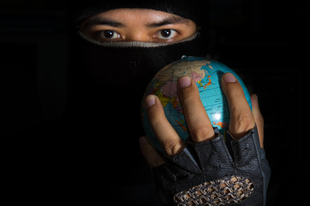 plunder: Terrorist hold globe in hand,social problem.