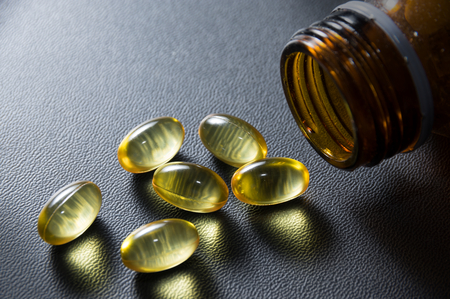 Omega 3 fish oil capsules,food supplement. Stock Photo