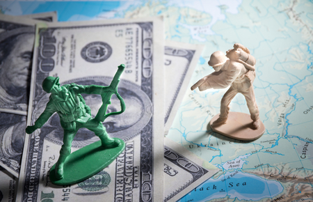 world war: Soldier toys on money and map,closeup. Stock Photo