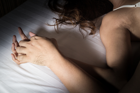 sex tenderness: Couple Man and woman hand in sex relationship on bed.
