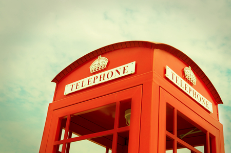 Traditional Red Phone booth,vintage filtered. Stock Photo
