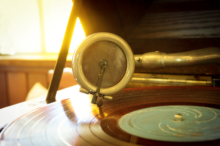 stylus: Old record player stylus on a rotating disc Stock Photo