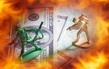 guerrilla warfare: Soldier toys on money and map with fire flame screen. War concept.