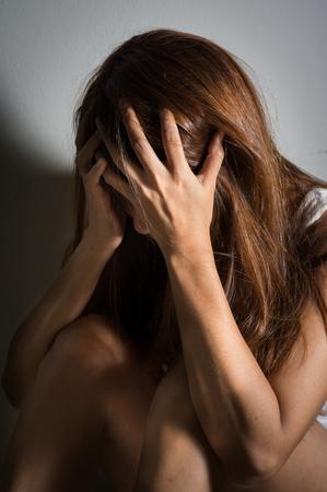 sad lonely girl: Sad girl sitting and crying Stock Photo