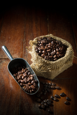 gunny: Still life coffee beans in metal scoop and gunny sack. Stock Photo