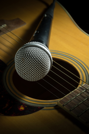 Microphone on acoustic guitar Stock Photo