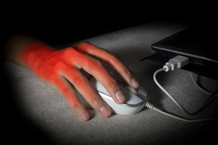 finger on trigger: Female hand got pain from using mouse.