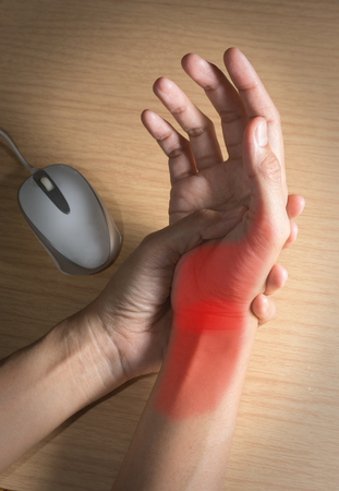 Female hand got pain from using mouse.
