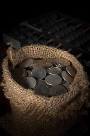 gunny: Coin in gunny sack,still life.