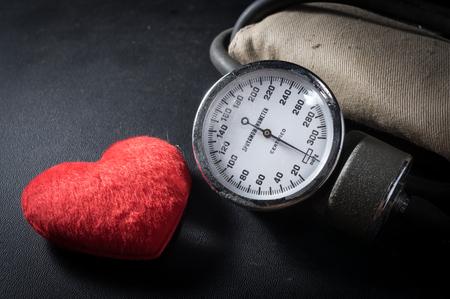 sphygmomanometer: Old Sphygmomanometer with red heart