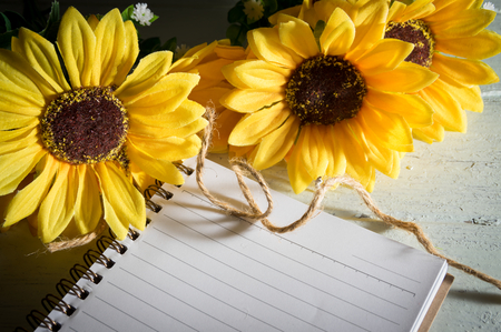 Book with sun flowers on table,still life.