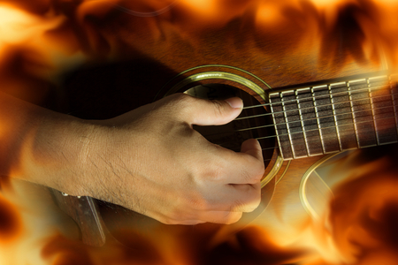Playing guitar with fire flame screen.