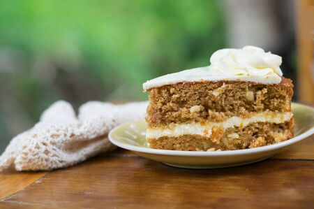 Slice of carrot cake on plate Stock Photo