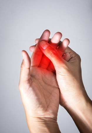 Woman suffered with finger pain. Stock Photo