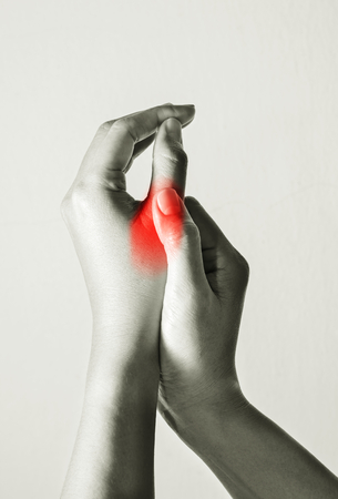 Woman suffered with finger pain. Stok Fotoğraf