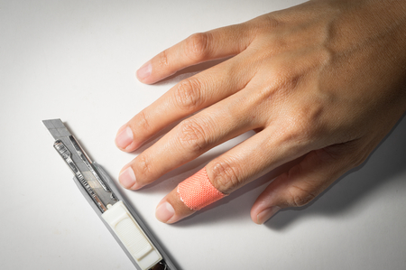 Woman finger with adhesive bandage