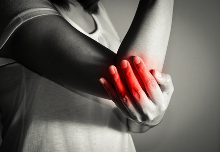 Woman suffering from elbow pain.