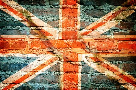 Vintage grunge filtered,United Kingdom flag on brick.
