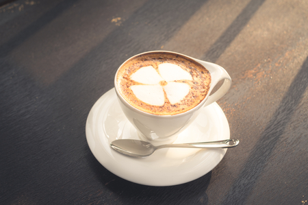 Cappuccino coffee in white cup. Stock Photo