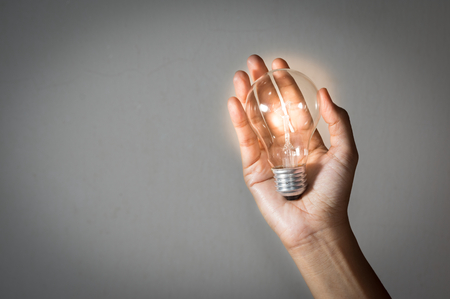 Light bulb in woman hand,concept idea. Stock Photo
